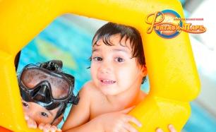 Отдых в аквапарке с безлимитным посещением водных горок и бассейнов или расширенный пакет: игровые симуляторы, аттракционы, бильярд, сертификат на блюда и напитки в развлекательном комплексе «Фэнтази Парк». Скидка до 65%